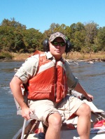 A Georgia Unit research technician using radio telemetry to track robust redhorse in the Oconee River