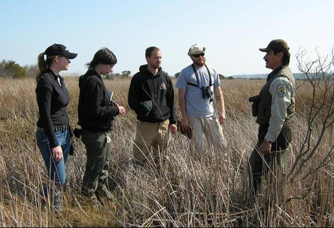 A field crew trains with King Rail expert prior to field season.