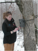 Unit graduate student, Abbey Thompson, prepares infrared digital cameras used to monitor deer behavior and interactions in research studies related to transmission of CWD.
